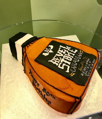 Whiskey Bottle Shaped Cake - Revel Stoke