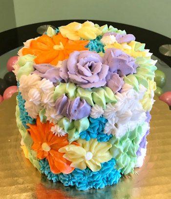 Assorted Flower Covered Layer Cake - Purple & Orange